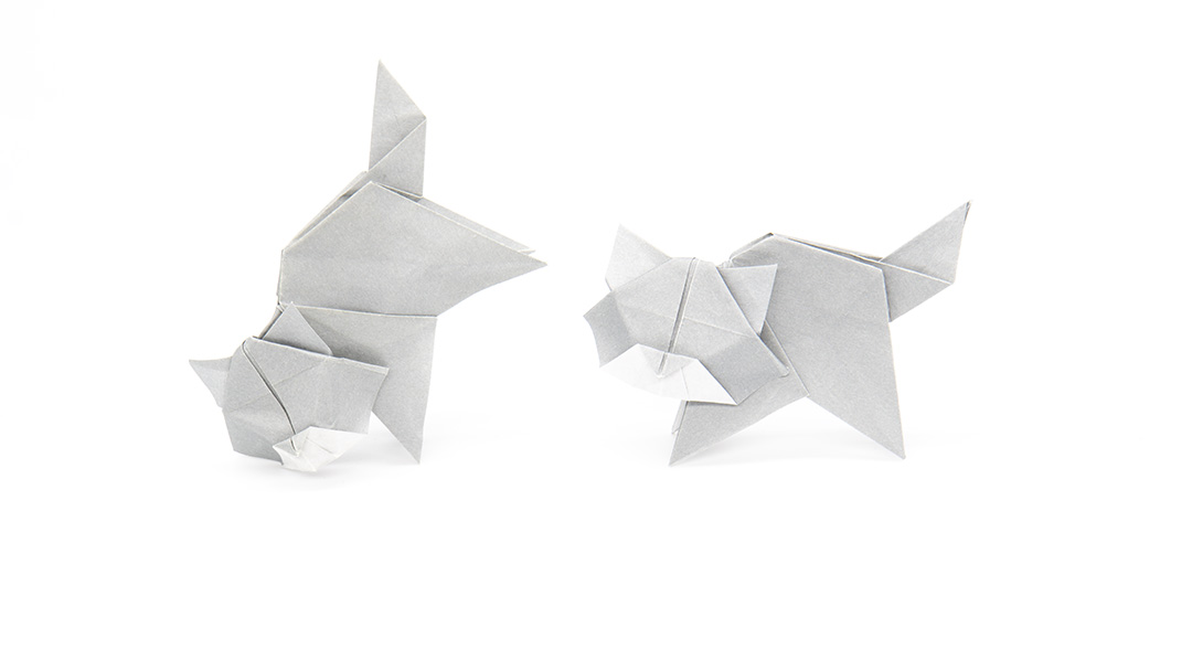 two playful origami cats