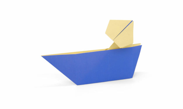 Origami man in a boat