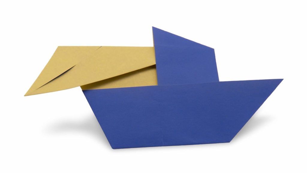 an origami man in a boat in progress