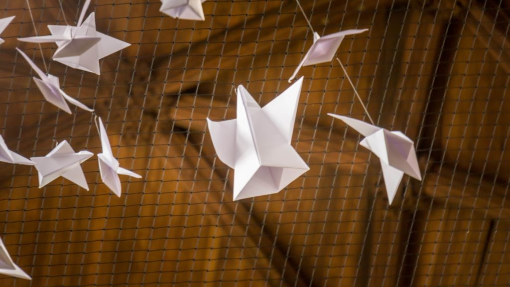 origami angels tied to the net