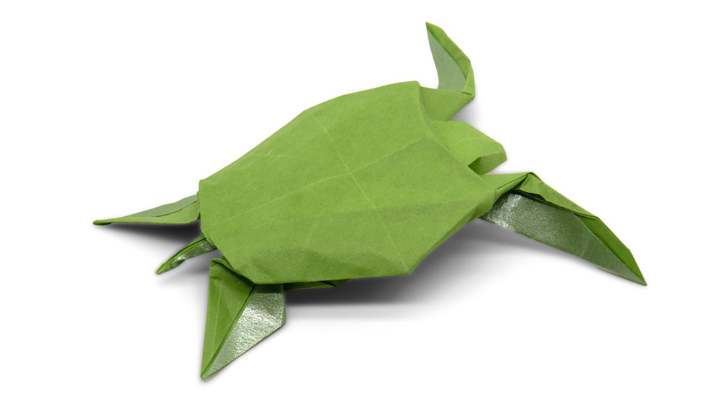 origami sea turtle designed by red paper from the book pure origami
