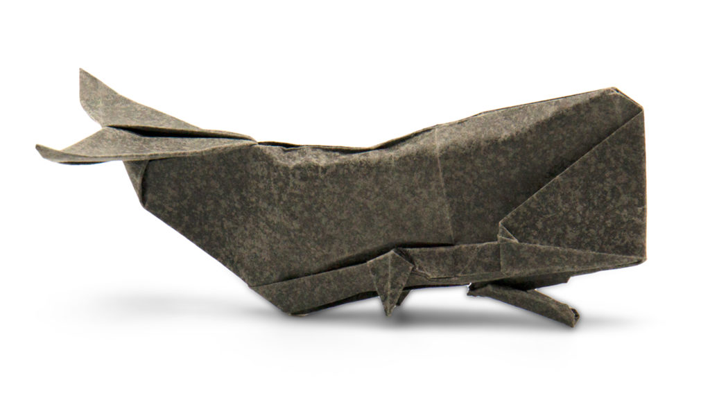 origami sperm whale designed by red paper from the book Pure Origami